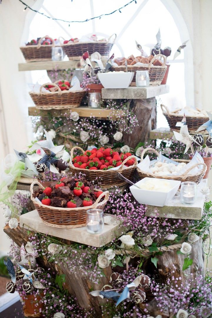 Gorgeous dessert table at the wedding reception. Flowers + fruits + sweets with a touch of whimsy | boho/bohemian wedding theme