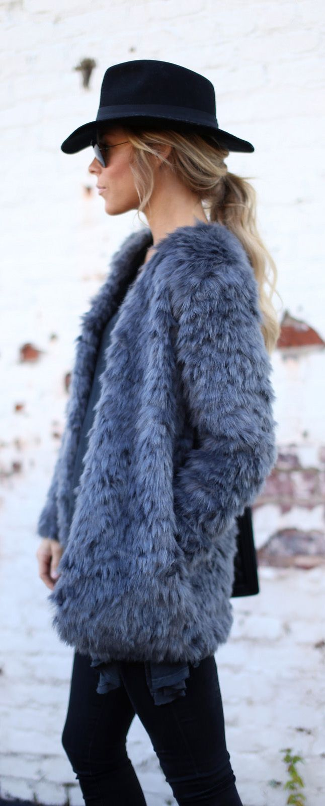 Mary Seng is wearing a faux fur fluffy grey coat for winter. This one is from Wayf