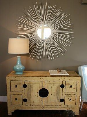 DIY mirror: buy a cheap round mirror and hot glue dowel rods