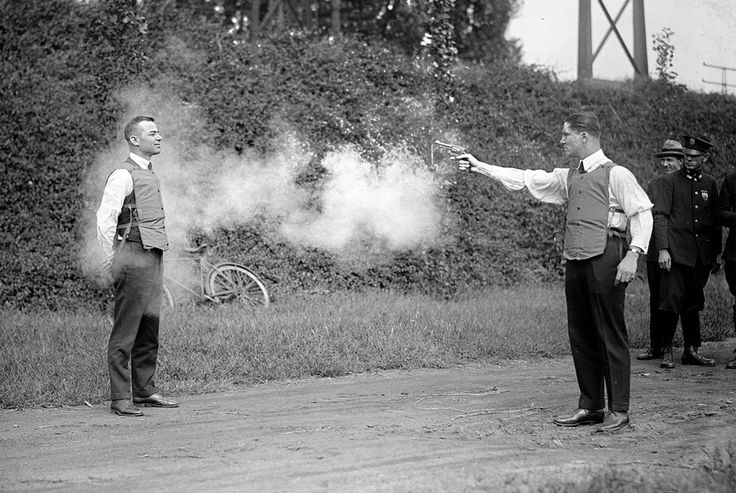"""1923 testing of the bulletproof vest  """"Excuse me Sir, the chaps from Occupational Health and Safety would like to have a word"""""""