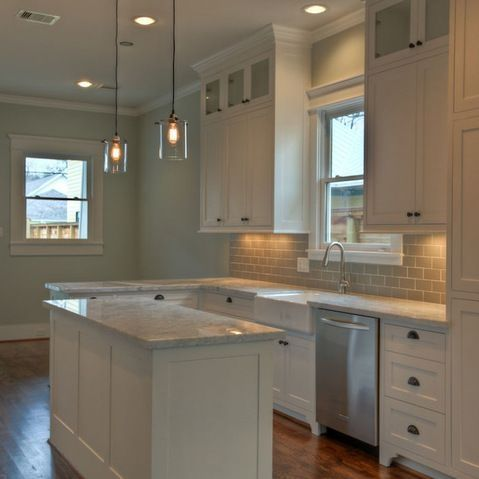 "white kitchen. I like the glass on the upper cabinet fronts and the ""furniture leg"" look on the bottom of the cabinets. by meghan"
