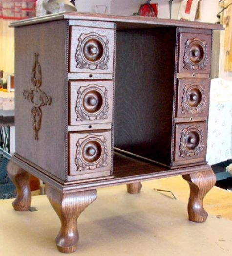 Made from old Treadle sewing machine drawers. Great for sewing table. Books stored in the middle.