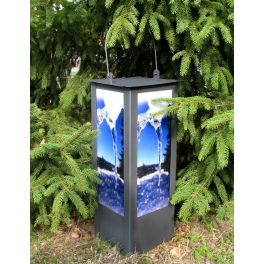 Classic metal lantern with a handle. Glassed walls are embellished with a UV print. Made by Neo-Spiro.
