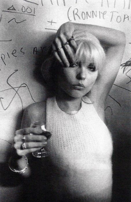 Debbie Harry. Drinking. Blondie on pause. For a moment.