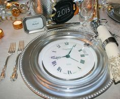 New Years Eve clock plates - love this idea! Dollar store clocks placed on chargers with clear glass plates over it... Voila!