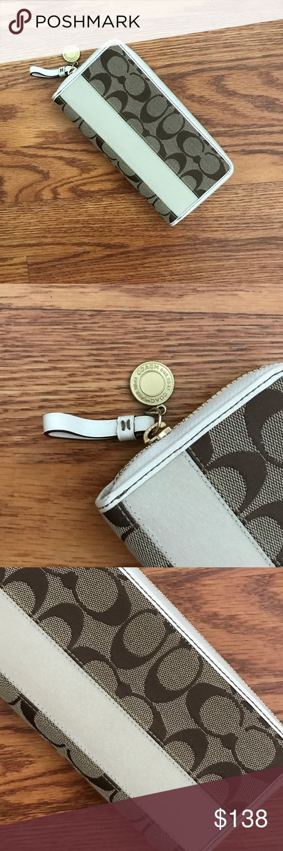 "Coach Legacy Signature Stripe Zip Around Wallet Coach Legacy Signature Stripe Zip Around Wallet in Khaki. NWOT. Authentic Coach wallet with goldtone hardware & khaki accents. Zip around closure. Interior is cream colored leather with the famous Legacy Stripe lining. 12 credit card slots, 3 billfold slots and a center zip coin pocket. Measurements: 8""L x 4""H x 1""D. Never been used excellent condition. Feel free to ask questions. No trades. Coach Bags Wallets"
