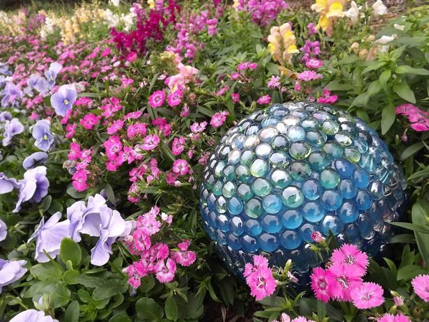 A gorgeous gazing ball can add sparkle to your planting bed. With just an old bowling ball, some embellishments and adhesive, you can create this beautiful accent in less than a day. Unleash your creativity...