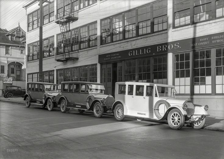 """Shorpy > Custom Bodies: San Francisco, 1924. """"Pierce-Arrow autos at Gillig Bros."""" Specialists in Body Building, Seat Covers, Auto Painting and Upholstery. Now playing at the Royal: """"Single Wives."""" 5x7 glass negative by Christopher Helin."""