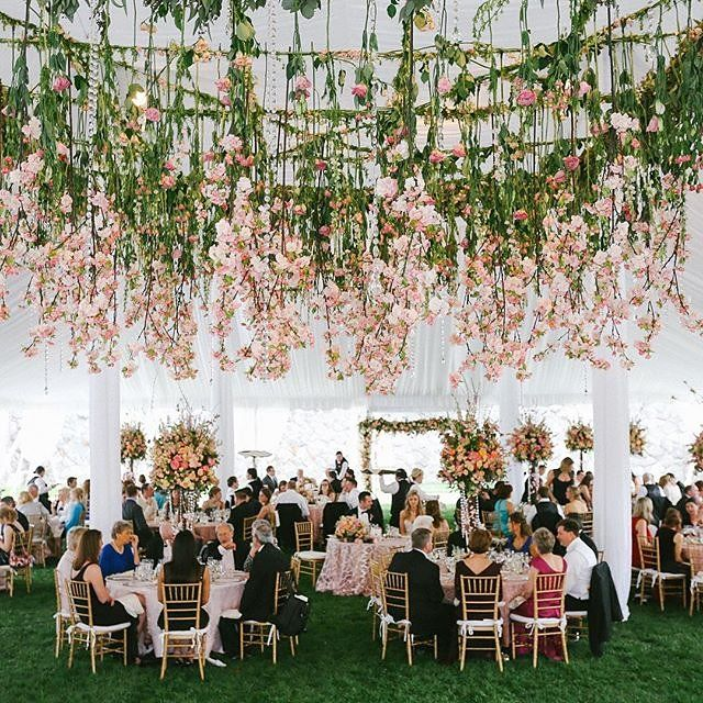 Looking to fill a large room or tent? Hang blooms from the ceiling.