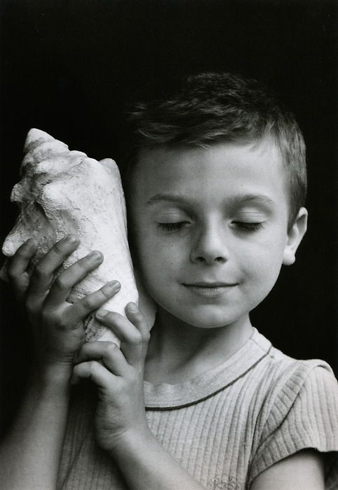 "Édouard Boubat - ""Rémi holding a shell"" / ""Rémi Listening To The Sea"", Paris, France 1995. S)"