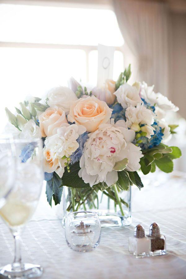 #centerpiece  Photography: Lark Photography - www.larkphotos.com Fashion: Coren Moore - www.corenmoore.com  Read More: http://stylemepretty.com/2010/07/19/wedding-gown-bridesmaids-dresses-by-coren-moore/