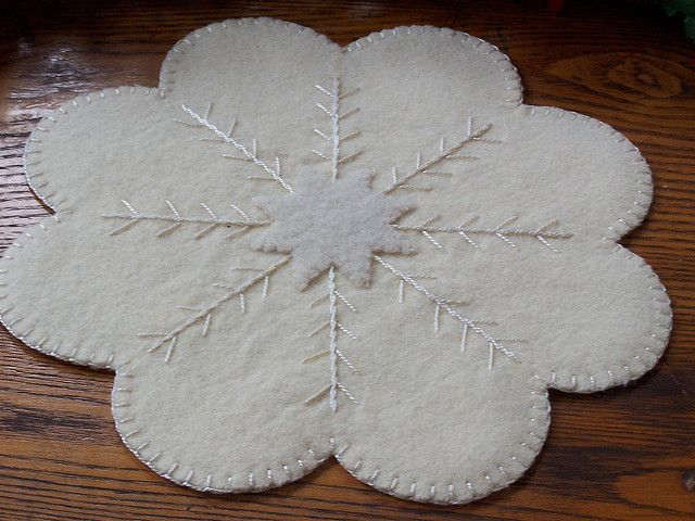 White wool candle mat.