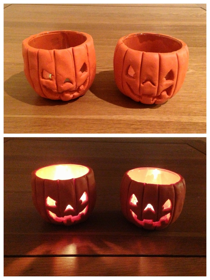 I had loads of old glasses hanging around from used candles, and decided to make them into a Halloween themed tea light holders. I wrapped them in some orange Fimo oven bake clay, and carved faces and pumpkin style grooves to turn them into these Jack-o-lanterns!