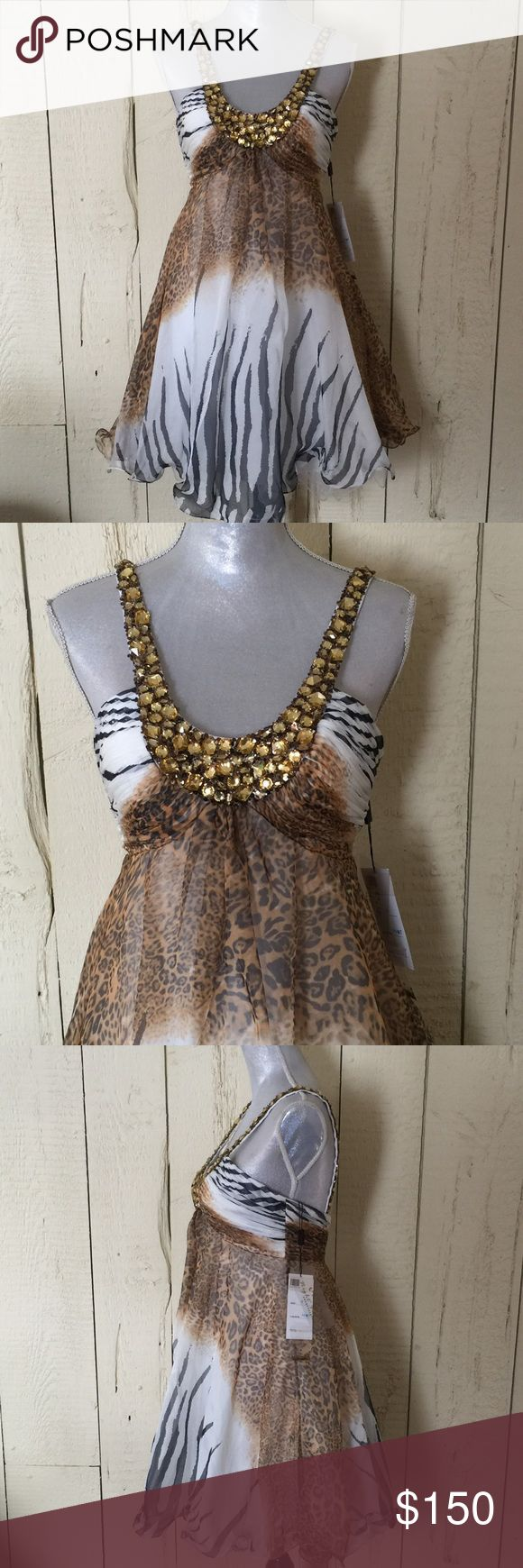 Animal Print Formal Rhinestoned collared and strapped. Great for the animal print lover on a special night! Has tulle inside to flare lil on bottom. Night Moves Prom Collection Dresses Prom