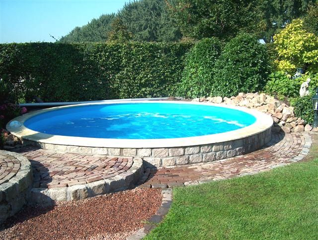 beautiful round pool in a garden stone pavers pinterest rounding gardens and swimming pools. Black Bedroom Furniture Sets. Home Design Ideas