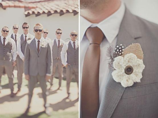 Groom in suit, groomsmen in vests