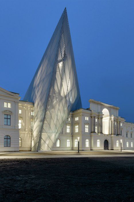 Now the official museum of the German Armed Forces, the Dresden Museum of Military History was once shut down by a German government uncertain of how the institution would fit into a newly unified German state. Studio Libeskind was selected as design architect for an extension in 2001, when an architectural competition was held. The winning design boldly interrupts the original building's classical symmetry. The extension, a massive, five-story 14,500-ton wedge of glass, concrete, and