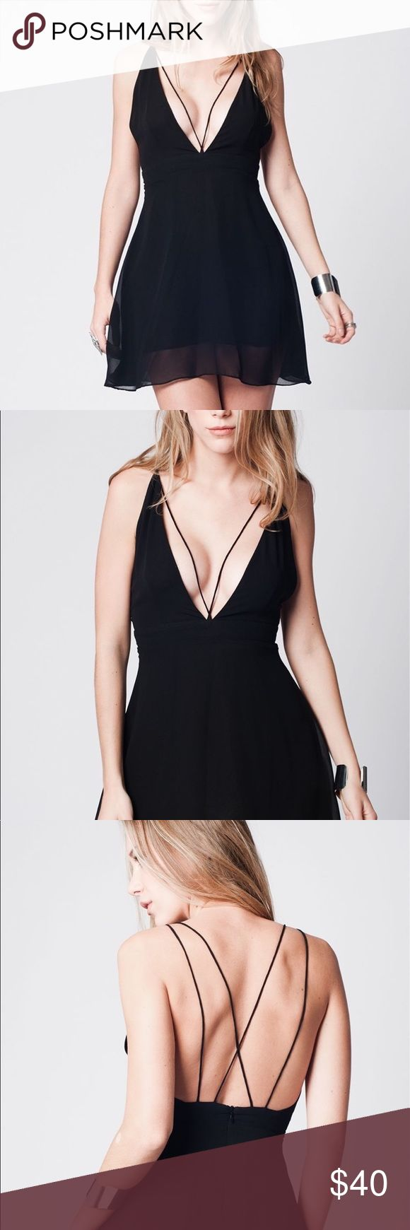 🆕 Black Deep V Cross Back Straps Short Dress The plunging V neckline and cage straps are perfect for this short, flirty little black dress. Very low cut back features a zipper a crossing straps in that ensure the perfect fit. Entire dress is lined and has a super soft opaque polyester slip with a sheer overlay.    100% Polyester Lining: 100% Polyester    SM - US 6 EU 36  MD - US 8 EU 38  Goth Gothic Punk Bondage Boho Chic Bohemian PinUp Rockabilly LBD Club Festival Chiffon Dolls Kill Bebe…