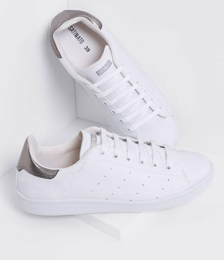 Tênis feminino    Material: sintético    Com detalhe metalizado    Marca: Satinato             COLEÇÃO VERÃO 2017         Veja mais opções de    tênis femininos.                    Satinato         A Satinato possui uma coleção de sapatos, bolsas e acessórios cheios de tendências de moda. 90% dos seus produtos são em couro. A principal característica dos Sapatos Santinato são o conforto, moda e qualidade! Com diferentes opções e estilos de sapatos, bolsas e acessórios. A Satinato também…