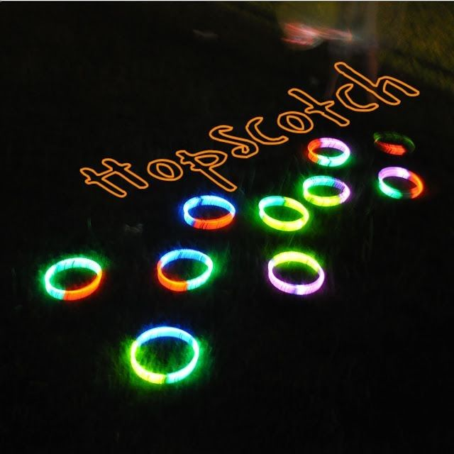 Glow in the Dark Party hop scotch - glow in the dark ring toss, punch balloons with glow bracelets inside.