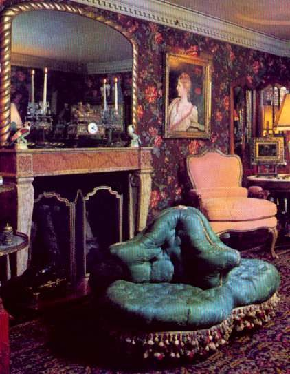 Victorian interiors. Home interiors were quite dark with busily patterned wallpaper.  From a picture rail hung oil paintings, etchings, engravings, silhouettes, water colours, stitched needlework samplers and hand embroidered reproductions of famous paintings.  Sunlight was kept out of the already dark room by layers of blinds, lace curtains, velvet drapes, and side curtains in dark colours.The brass ringed curtains hung on great poles, but often remained drawn on bright days.
