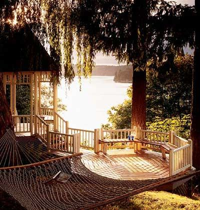 "Love this Deck!!  The big idea here is the ""gazebo deck,"" with seating built into the railing. The two octagonal platforms -- one open, the other covered -- are connected by a slender bridge and stair to form an elegant box seat for a calming water view."