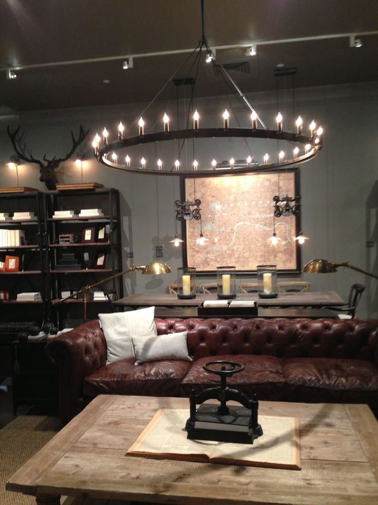 Tufted leather sofa, wood coffee table & love that huge industrial chandelier