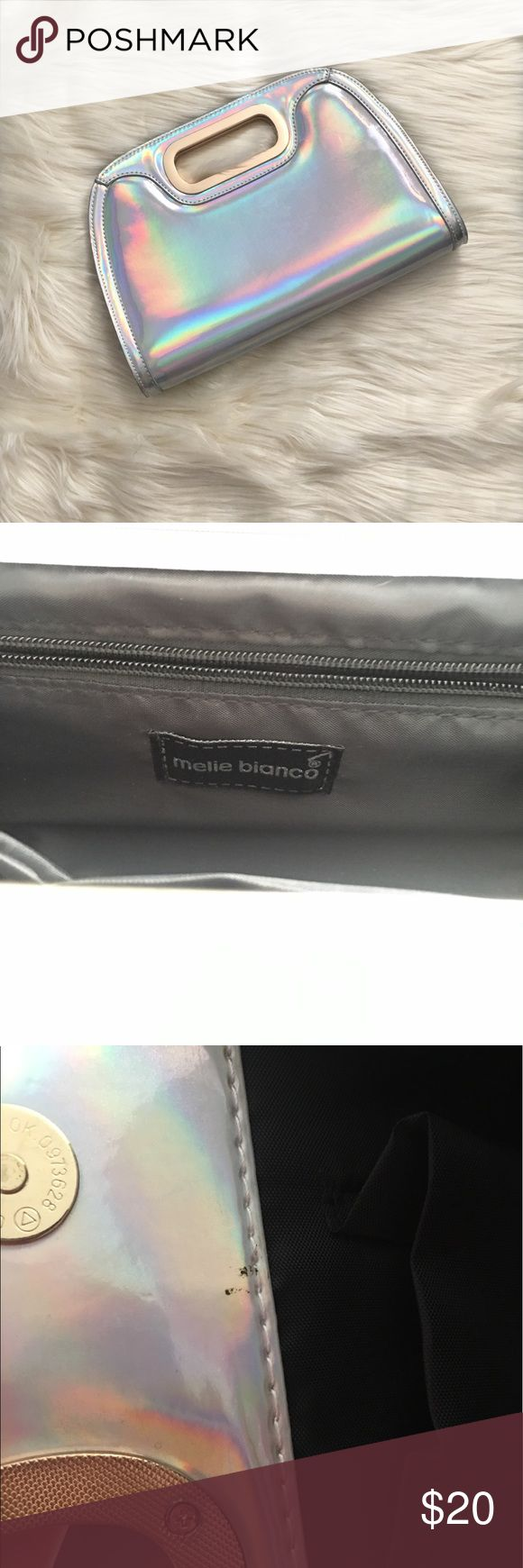 Melie Bianco vegan leather holographic clutch Melie Bianco vegan leather holographic clutch. Scuffs as shown in pictures. Don't like my price? Make an offer. Melie Bianco Bags Clutches & Wristlets