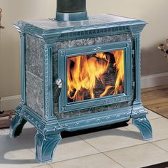 Hearthstone Tribute Soapstone wood stove. . . . 1K sq ft.  Burns 7 hours, stays hot for 9.
