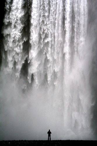 Man vs. Nature. The picture was taken at Skógarfoss 11th of June 2005. I wonder what it sounds and feels like standing that close...
