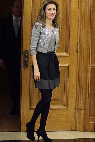 Sequin cardi, gray top, black skirt, tights, heels.  Doña Letizia