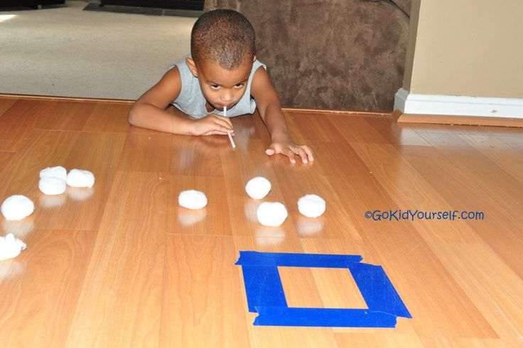 Blow cotton balls into masking tape squares. Tape different size squares at different distances from starting point.