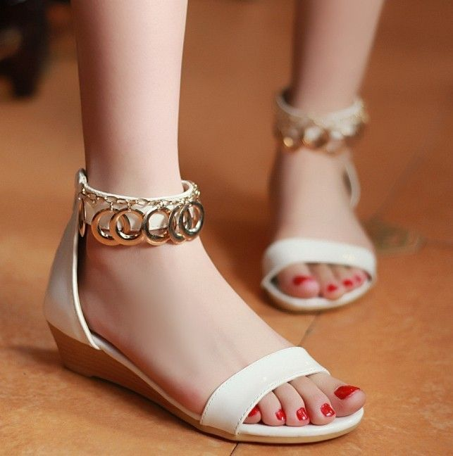 This sandal has wooden style sole and white simple toe strap and ankle strap.  Toe