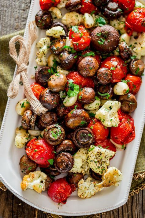 Italian Roasted Mushrooms and Veggies: This veggie side is full of flavor and texture! Find more easy and delicious non-traditional and traditional Christmas dinner menu ideas and recipes including appetizers, entrees, desserts, drinks and main courses here.