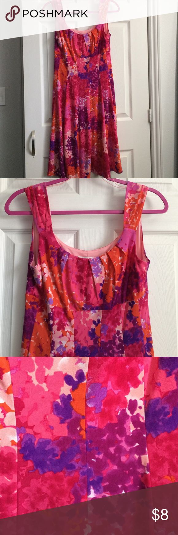 Flowing sleeveless pink, coral, purple dress Very pretty feminine flowing dress. Great for a spring or summer event, or any season if you're in California! Pink, purple, orange and coral colors in a beautiful pattern. Panels, fit and hemline are very flattering and easy to wear. Light stretch, pink lining. Gently used. Purchased at Macy's. Ask for a custom bundle for the best discount! Dresses