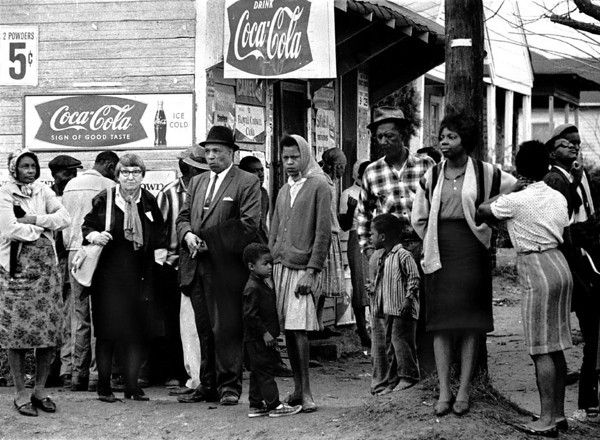 people on street corner watching marchers of the selma to montgomery alabama civil rights