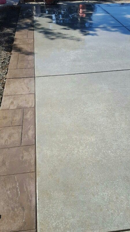 Finished product!! Driveway broom finish with stamp perimeter driveway by KRCC
