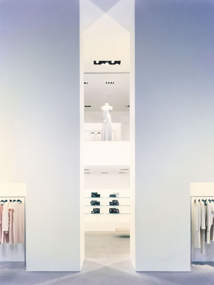 Structural columns inside the white Calvin Klein store in New York by John Pawson _