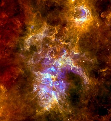 Giant bubbles, towering pillars and cascading clouds of dust and gas fill the star-forming nursery of the Carina Nebula seen here in a stunning new view from Herschel to launch ESA Space Science's image of the week feature.