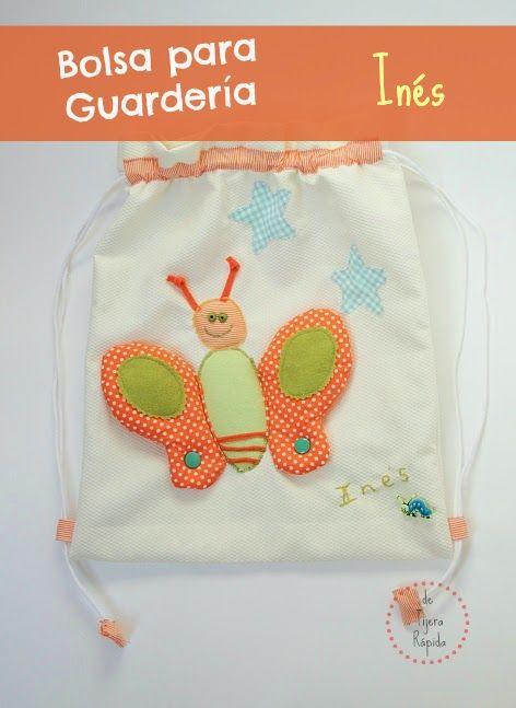 Bolsa para guarderia personalizada en tonos naranjas y verdes con una mariposa en relieve. Las alas se pueden mover para jugar con ellas.