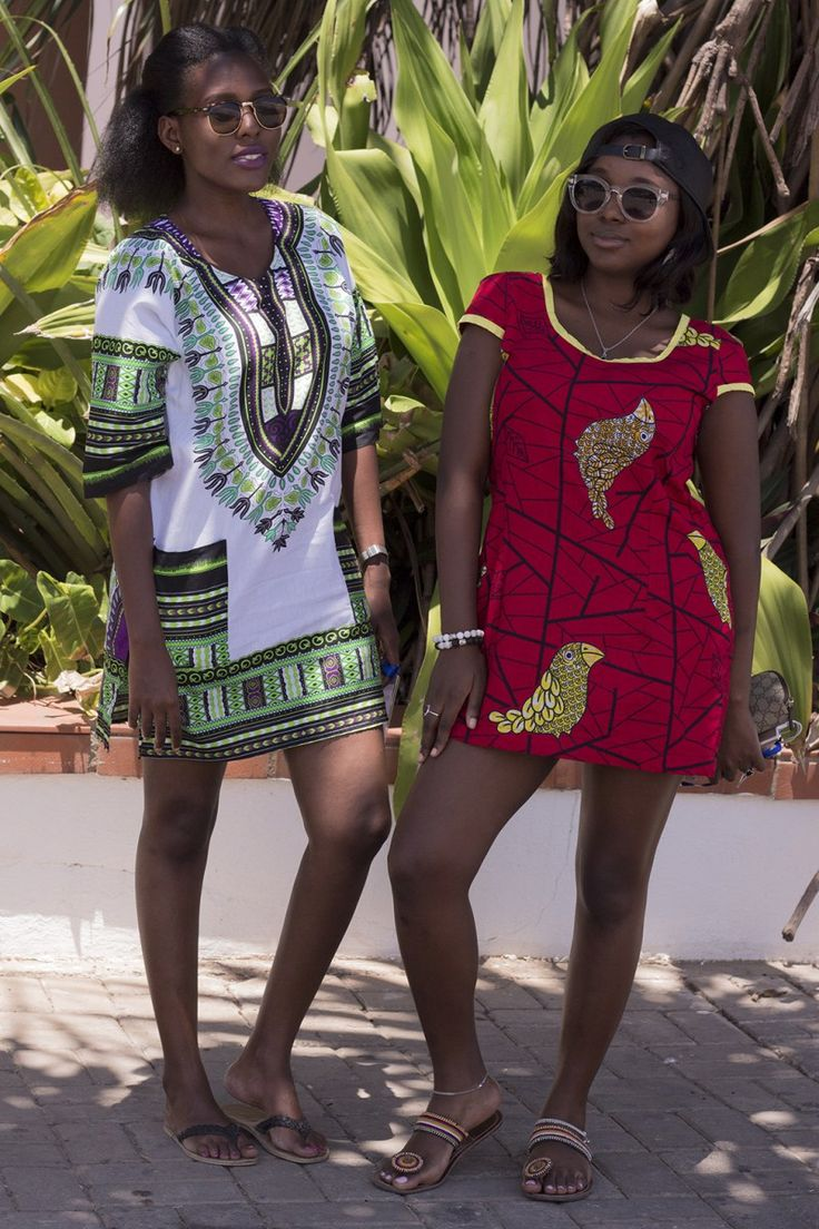 We love caps worn with cute bird printed dresses, seen at the Swahili Fashion…
