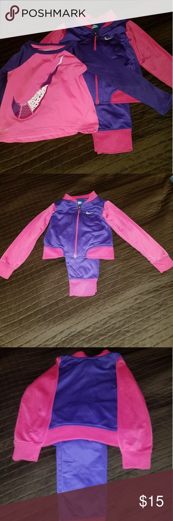 Nike girls warm up suit. Pink and purple girls Nike jogging suit. As a bonus, including the Dri-Fit shirt. EUC Nike Matching Sets