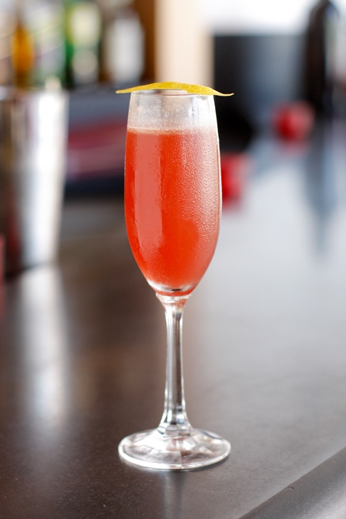 """Teatro ZinZanni has created the """"Coastal Kiss"""" in honor of its upcoming engagement at Segerstrom Center.  1/2 oz. - Logis de la Mothe Cognac   1/2 oz. - Briottet Crème de Cassis   3/4 oz. - Lemon Juice   Champagne to top (approx. 3-4 oz.)     Build Cognac, Crème de Cassis and lemon juice in a shaker tin. Shake with ice and strain into chilled champagne flute. Top with champagne flute and garnish with fresh blackberry.    Cheers!"""