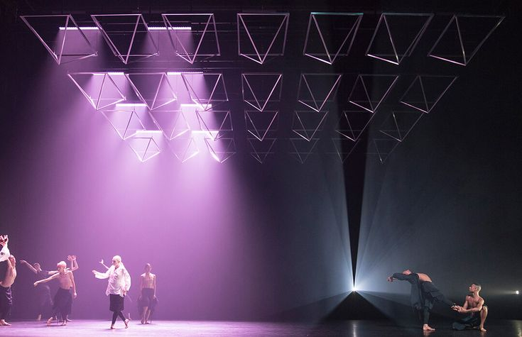 An adaptable aluminium ceiling and atmospheric lighting defines the context for Wayne McGregor's new dance performance Autobiography.