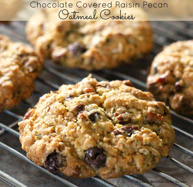 Chocolate Covered Raisin Pecan Oatmeal Cookies - Oatmeal cookies are a childhood favorite of mine. Made with or without raisins the chewy texture that the oatmeal adds to them, along with the crispy golden edges appeals to my personal taste.