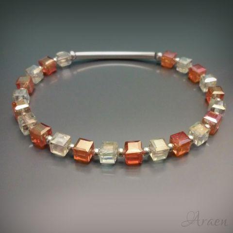 Orange and topaz colored sparkling crystal cubes bracelet