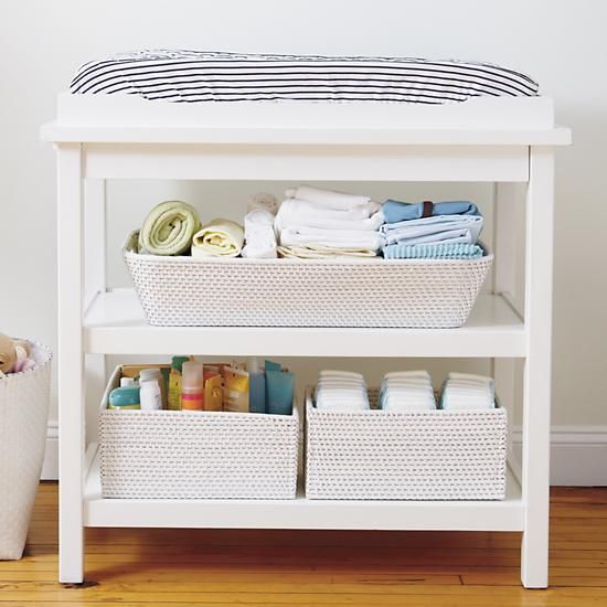 changing table with storage below. removable changer to continue using piece after no longer needed as changer.