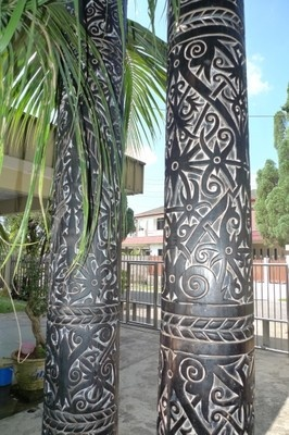 Dayak ritual poles carved from Kayu Malam