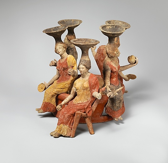 Terracotta group of women seated around a well head  Classical period 2nd half of 4th century BCE, Greek, Tarentine, Italy.  Metropolitan Museum