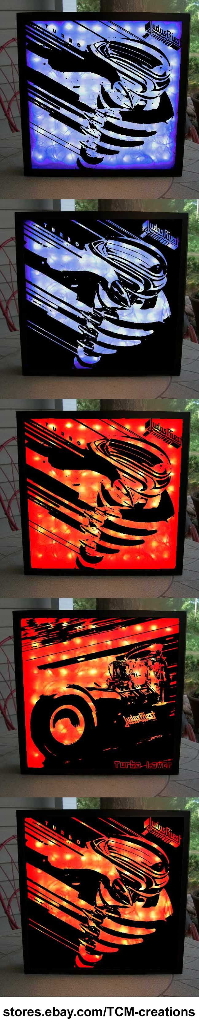 Judas Priest Shadow Boxes with LED lighting. Rocka Rolla, Sad Wings Of Destiny, Sin After Sin, Stained Class, Killing Machine, British Steel, Point Of Entry, Screaming For Vengeance, Defenders Of The Faith, Turbo, Ram It Down, Painkiller, Jugulator, Demolition, Angel Of Retribution, Nostradamus, Redeemer Of Souls, Unleashed In The East, Priest... Live!, 98 Live Meltdown, Live In London, A Touch Of Evil... Live, Battle Cry, Rob Halford, Glenn Tipton, K.K. Downing.